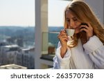 drinking coffee at home.... | Shutterstock . vector #263570738