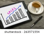 Small photo of sales graph concept hand drawing on tablet pc