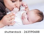 young happy beautiful mother...   Shutterstock . vector #263590688