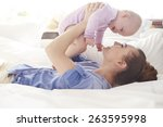 fun with mother in the bed  | Shutterstock . vector #263595998