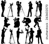 cameraman with video camera.... | Shutterstock .eps vector #263602070