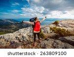 young woman mountain climber...   Shutterstock . vector #263809100