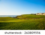 Half Moon Bay grass field and villa houses.  Golf course.