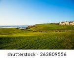 Half Moon Bay grass field and villa houses.  Golf course.
