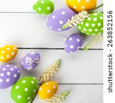 easter eggs with spring flowers.... | Shutterstock . vector #263852156