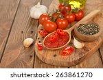 tomato paste in wooden spoon on ... | Shutterstock . vector #263861270