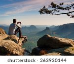 tourist in grey t shirt takes... | Shutterstock . vector #263930144