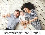 happy young father  mother and... | Shutterstock . vector #264029858