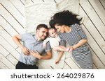 happy young father  mother and... | Shutterstock . vector #264029876