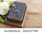 holy bible and white rosary....   Shutterstock . vector #264137768
