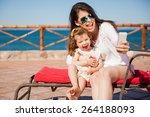 little girl and her mom having... | Shutterstock . vector #264188093