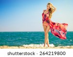 young woman on the beach | Shutterstock . vector #264219800