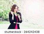 beautiful girl in spring cherry ...   Shutterstock . vector #264242438