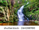 Waterfall In Mountains. Famous...