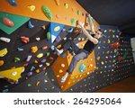 young man practicing bouldering ... | Shutterstock . vector #264295064