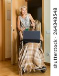 happy woman in wheelchair with... | Shutterstock . vector #264348548