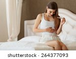 happy woman with pregnancy test | Shutterstock . vector #264377093