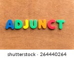 Small photo of adjunct colorful word on the wooden background