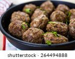 frying large homemade italian... | Shutterstock . vector #264494888