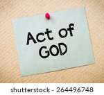 Small photo of Act of God Message. Recycled paper note pinned on cork board. Concept Image