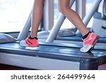 fit female legs on a treadmill...   Shutterstock . vector #264499964