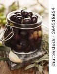 jar with pickled kalamata olives | Shutterstock . vector #264518654