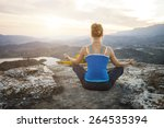 young woman sitting on a rock...   Shutterstock . vector #264535394