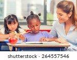 happy teacher in elementary... | Shutterstock . vector #264557546