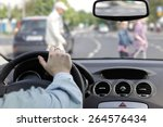 The Driver And A Pedestrian At...