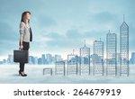 business woman climbing up on... | Shutterstock . vector #264679919