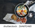 pan of fried eggs  bacon and... | Shutterstock . vector #264691460