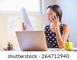 a young businesswoman talking...   Shutterstock . vector #264712940