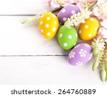 easter eggs with spring flowers.... | Shutterstock . vector #264760889