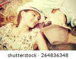 happy young couple relaxing on... | Shutterstock . vector #264836348