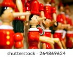 Small photo of Traditional wooden Pinocchio toy. Italy.