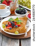 breakfast   crepes with fresh...   Shutterstock . vector #264880970