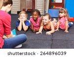 nursery teacher reading story... | Shutterstock . vector #264896039