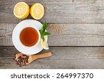green tea with lemon and mint... | Shutterstock . vector #264997370
