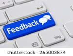 a keyboard with a blue button   ... | Shutterstock . vector #265003874