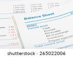 Small photo of Balance sheet in stockholder report book, document is mock-up