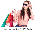 lovely woman with shopping bags ... | Shutterstock . vector #265028414