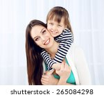 two girls smiling on home...   Shutterstock . vector #265084298