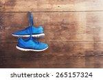 Pair Of Sneakers Hang On A Nai...