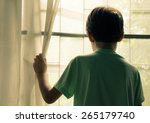Little Boy Standing Behind The...