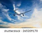 air plane flying on blue sky | Shutterstock . vector #265209170