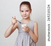 cute little girl holding milky... | Shutterstock . vector #265210124