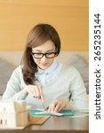 asian woman working at home | Shutterstock . vector #265235144