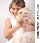 portrait of a cute girl hugging ... | Shutterstock . vector #265243820