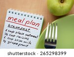 paper with meal plan and  apple.... | Shutterstock . vector #265298399