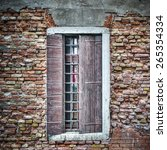 old window in a brick wall in... | Shutterstock . vector #265354334